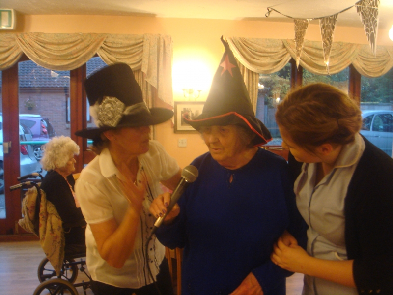 Resident Mary singing for the show with Care Assistant Ellie and Entertainer ELaine