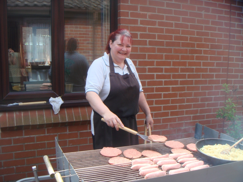 Sarah getting the hot dogs and burgers cooked on the barbeque!