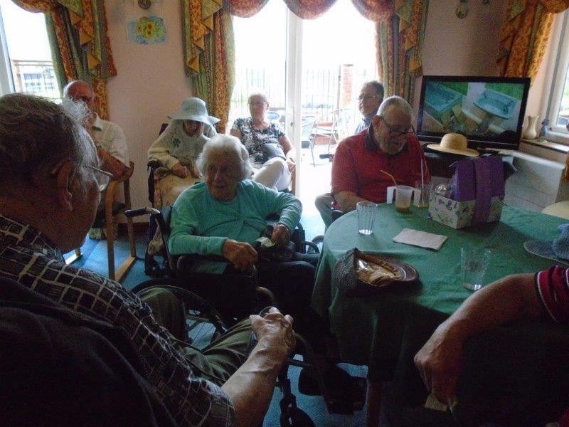 Residents and relatives in the main lounge for our fete at Dorrington House Wells