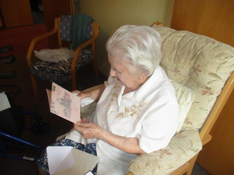 Sarah reading her birthday card from Dorrington House Watton