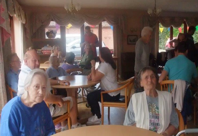 Residents and relatives all gathered to see if their raffle tickets are picked out at Dorrington House Dereham's Fete!