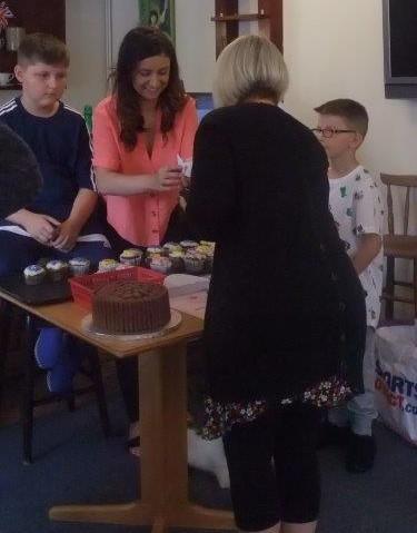 Carer Francesca selling her homemade cup cakes at Dorrington House Dereham's Fete 2018!