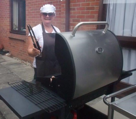 Our cook Sarah cooking up burgers and hotdogs for Dorrington House Dereham's fete 2018!