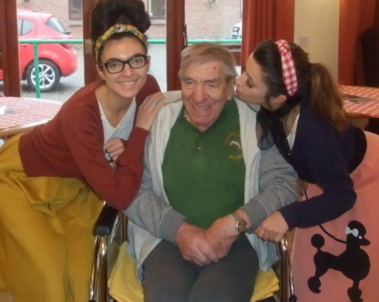 Our Activities Co-ordinator Elizabeth with Resident Norman and Carer Francesca at our 50s themed dancing for dignity event at Dorrington House Dereham!