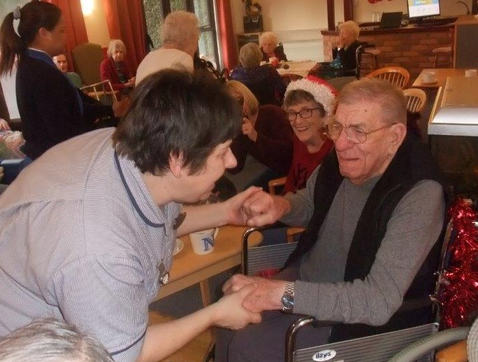Carer Jane with Resident Norman at Dorrington House Dereham's residents & relatives christmas party!