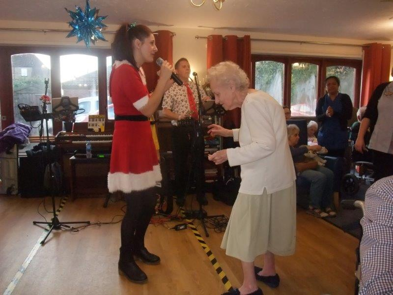 Resident Maria on the dance floor at Dorrington House Dereham's residents & relatives christmas party!