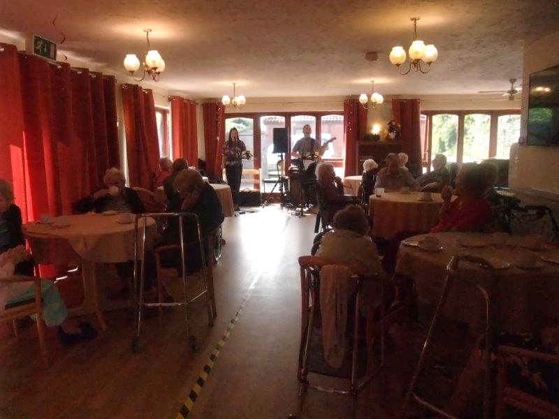 Our residents enjoying a musical performance from Splash Duo as part of Dorrington House Dereham's Easter Party 2019!