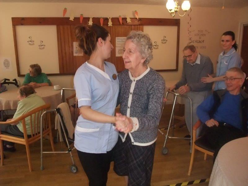 Resident Edna and Carer Francesca having a dance together at Dorrington House Dereham's Easter Party!