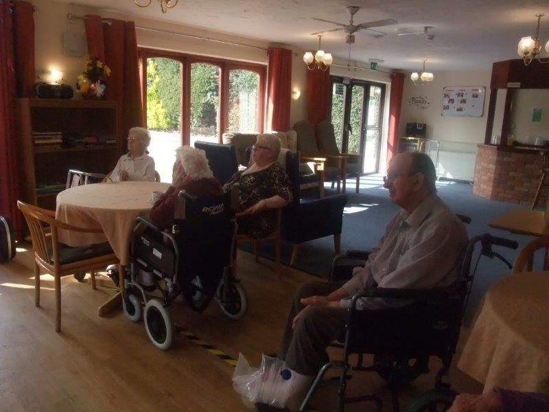 Residents; Betty, Margaret, Mary and Basil enjoying the musical performance by splash duo, at Dorrington House Dereham's Easter Party!