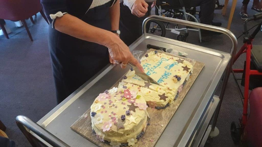 Cutting the birthday cake for Dorrington House Watton's 20th Birthday!