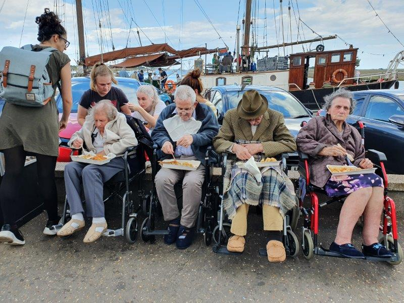 Our residents enjoying fish and chips by the quay as part of Dorrington House Dereham's trip to wells next the sea!