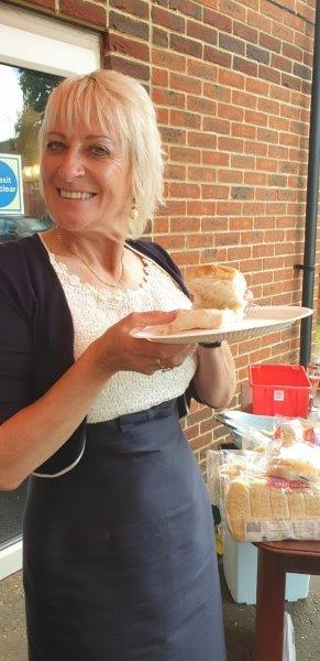 Owner Lorraine Dorrington helping serve food to relatives and residents at Dorrington House Watton's 20th Birthday!