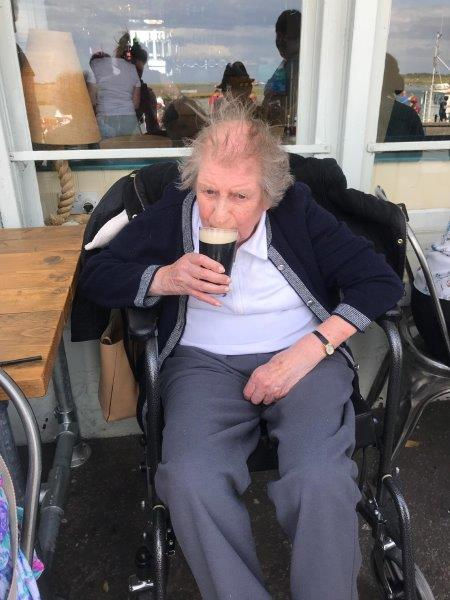Resident Marion having a nice cold beverage at wells next the sea as part of Dorrington House Dereham's trip to the coast!