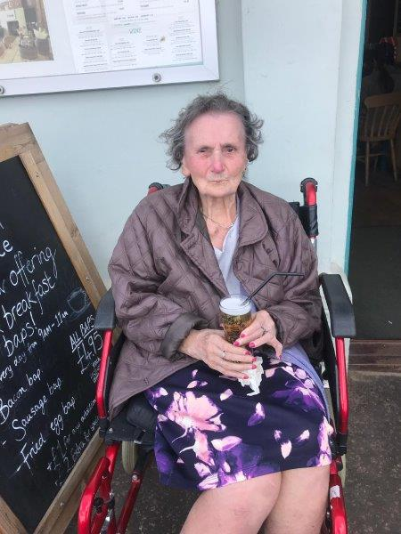 Resident Mavis having a nice cold beer at wells next the sea as part of Dorrington House Dereham's trip to the coast!