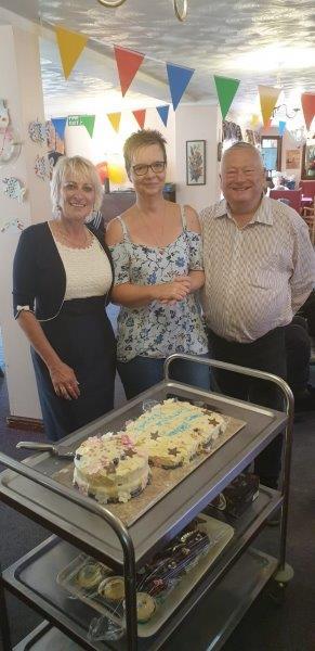 Steve and Lorraine Dorrington with Manager Cheryl getting ready to cut Dorrington House Wattons 20th Birthday Cake!