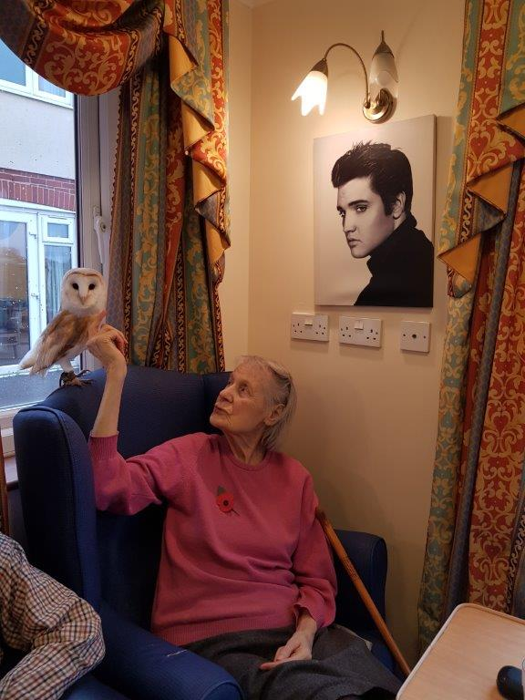 One of our residents Freda having a feel of the owls feathers from our Birds of Prey visit at Dorrington House Wells!