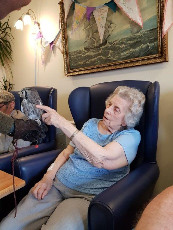 One of our residents Muriel having a close look at the Owl in front of her! From our Birds of Prey visit at Dorrington House Wells!
