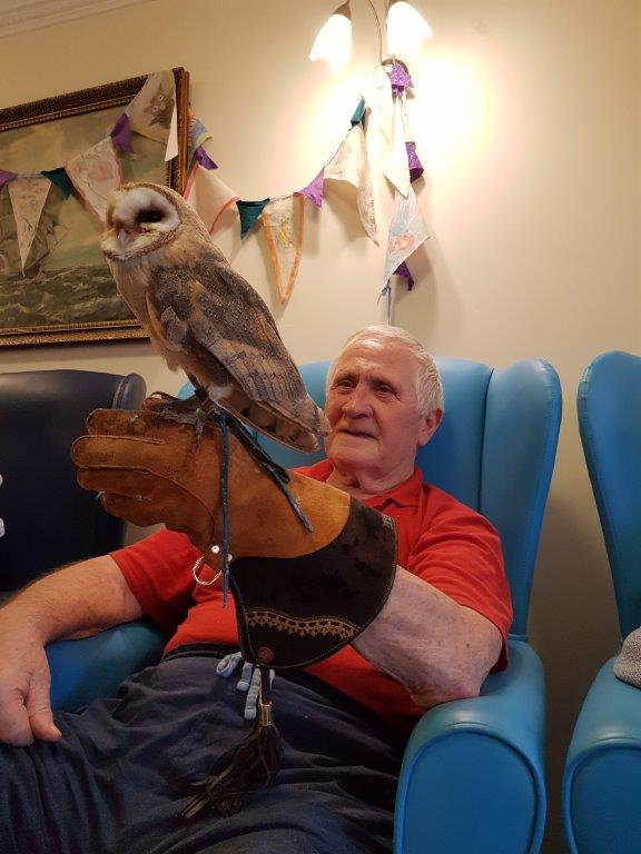One of our residents Paddy holding an owl! From our Birds of Prey visit at Dorrington House Wells!