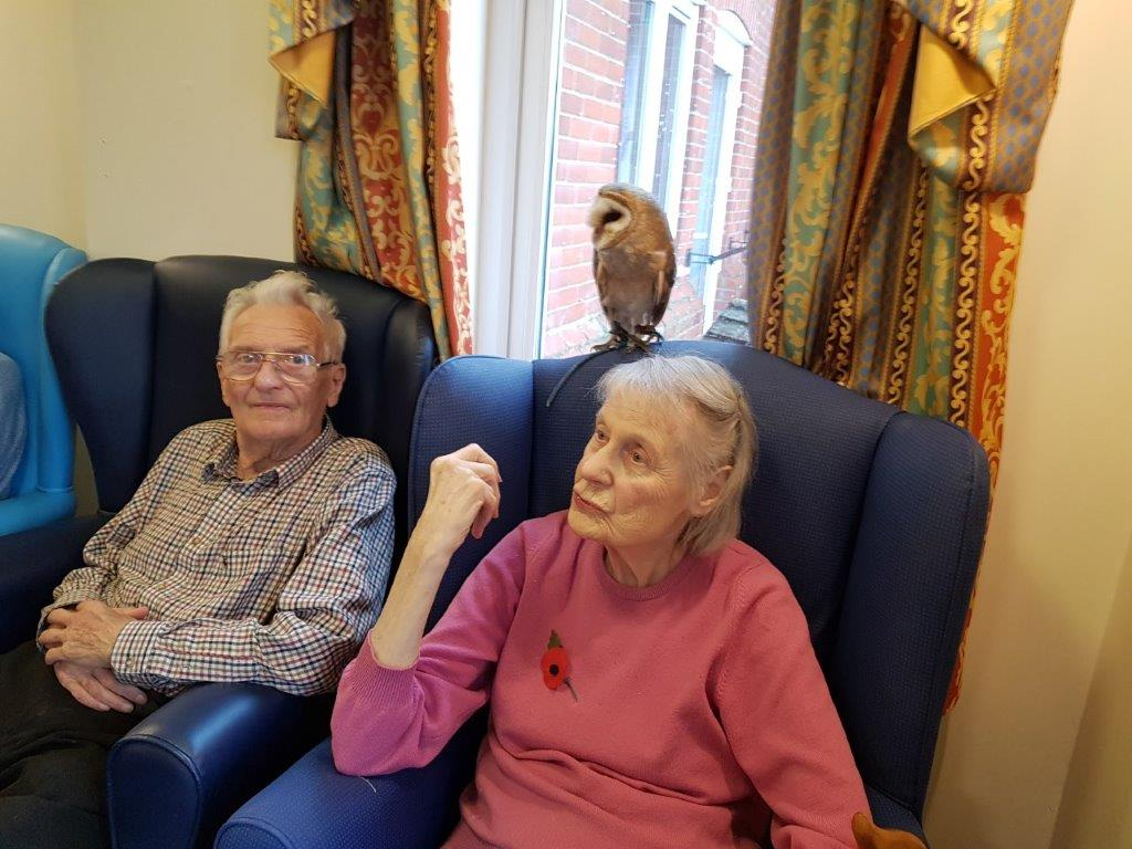 Residents; Freda and Stanley with an owl just behind them! From our Birds of Prey visit at Dorrington House Wells!